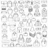 Large  set of black and white doddle fashion bags, hand drawn with black ink, isolated on white background. Illustration wit Royalty Free Stock Images