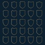 Large set of golden contour shields on blue background Royalty Free Stock Images