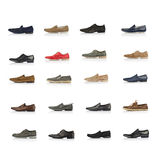 Large set of male shoes over white. Large collection of male shoes over white background Royalty Free Stock Images
