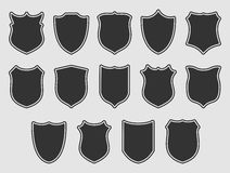 Large set of shields over grey background Royalty Free Stock Images