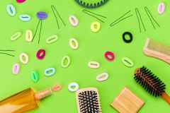 Large set for styling and care for hair on a green background Royalty Free Stock Photo