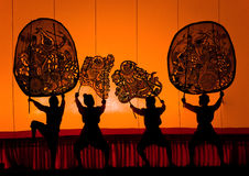 Thai performance art - Large Shadow Play. RATCHBURI, THAILAND - APRIL 13: Large Shadow Play is performed at Wat Khanon on April 13, 2010. The ancient performing Royalty Free Stock Images