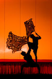 Thai performance art - Large Shadow Play. RATCHBURI, THAILAND - APRIL 13: Large Shadow Play is performed at Wat Khanon on April 13, 2010. The ancient performing Stock Photography