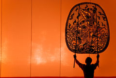 Thai performance art - Large Shadow Play. RATCHBURI, THAILAND - APRIL 13: Large Shadow Play is performed at Wat Khanon on April 13, 2010. The ancient performing Royalty Free Stock Photography