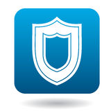 Large shield icon, simple style. Large shield icon in simple style in blue square. Weapon for war symbol Royalty Free Stock Photos
