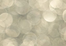 Large Shimmering Champagne Bokeh background. Large round shimmering champagne colored bokehs royalty free stock photos