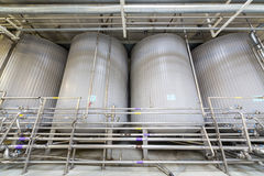 Large shiny tanks and tubing in the brewery Ochakovo Royalty Free Stock Image