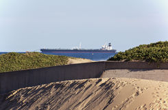 Large Ship Anchored At Sea Behind Estuary Royalty Free Stock Image
