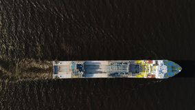 Large ship at the river - top down aerial view. stock footage