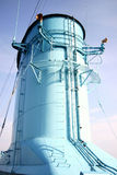 Large ship's funnel. A ship's large blue funnel with two mounted speakers for sounding the ship's horn Stock Photos