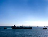 Large ship and tug boats Stock Image