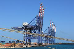 Shipping cranes at Freeport, Bahamas. Large Shipping cranes for moving containers stand ready for action at Freeport, Bahamas stock photo