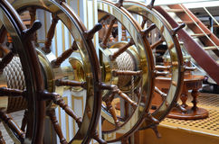 Large ships wheel at the helm of a sailing ship. Stock Image