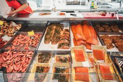 Large showcase with shrimp fish and seafood delicacies on the counter of the Norwegian fish market. Close up stock image