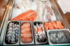 Large showcase with shrimp fish and seafood delicacies on the counter of the Norwegian fish market. Close up Stock Photo