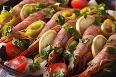 Large shrimp with lemon and vegetables macro. horizontal Royalty Free Stock Photos