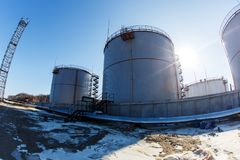 Large silver tanks for the storage of petroleum products in the open stock photos
