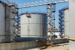 Large silver tanks for the storage of petroleum products in the open royalty free stock image