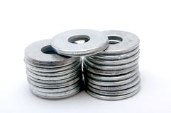 Large Silver Washers. Two stacks of large silver washers with two additional washers on top Stock Image