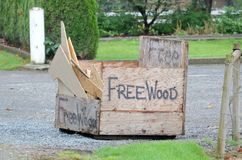 Recycling Wood Scraps. A large, simple box in the front yard invites anyone to help themselves to free wood royalty free stock image