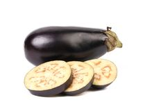 Large single eggplant and slices. Stock Images