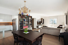 Large sitting room with dining table, interior Stock Photo