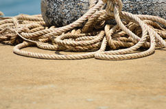 Large size of boat rope. Large size boat rope used to tide boats roll together in an untidy way Stock Photos