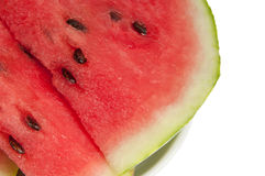Large slice of watermelon cut. A large piece of watermelon cut on a white background Royalty Free Stock Images