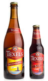 Large and small bottle of dutch Texels craft beer Royalty Free Stock Photo