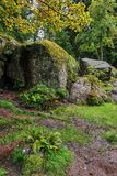 Large and small boulders create a beautiful composition in the form of a grotto cave. Natural park `Monrepo` in the city of Vyborg. Russia,Leningrad region Royalty Free Stock Photography