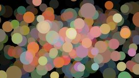 Large and small colorful particles or bubbles floating chaotically and blinking on the black background. Animation
