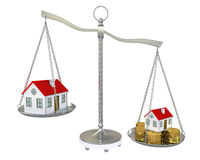 Large and small home with gold coins on the scale Royalty Free Stock Photography