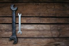 large and small, old and new, two wrenches on wooden background, copy space royalty free stock image
