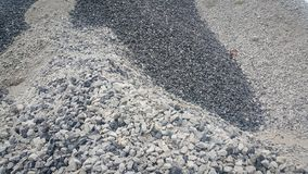 Large and small piles of limestone for use in lime kiln line . Limestone gravel background Texture royalty free stock photography
