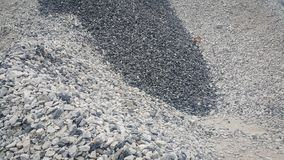 Large and small piles of limestone for use in lime kiln line . Limestone gravel background Texture stock photos