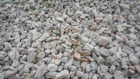 Large and small piles of limestone for use in lime kiln line . Limestone gravel background Texture royalty free stock photo