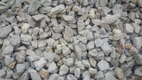 Large and small piles of limestone for use in lime kiln line . Limestone gravel background Texture stock image