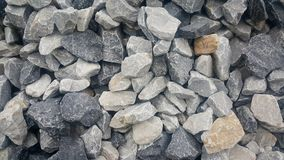 Large and small piles of limestone for use in lime kiln line . Limestone gravel background Texture stock photo