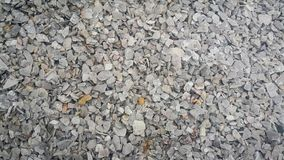 Large and small piles of limestone for use in lime kiln line . Small piles of limestone for use in lime kiln line . Limestone gravel background Texture royalty free stock images