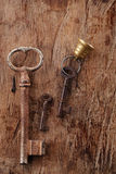 Large and small rusty vintage metal keys on old wooden backgroun Stock Photography