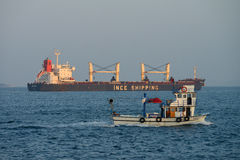 Large and small ship sails in Bosporus Royalty Free Stock Image