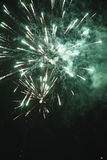 A large and a small two bright fireworks. Black background in the explosion of two drag one large and one small flame bright fireworks Stock Images
