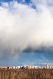 Large snow cloud over city and forest Royalty Free Stock Photo