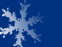 Large snowflake background. A large light blue snowflake on a solid medium blue background Royalty Free Stock Photography