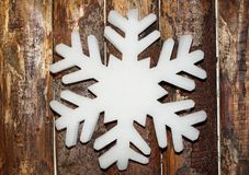 Large snowflake hanging on the wall Royalty Free Stock Photo