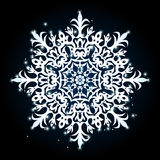 Large snowflake with translucent patches of light on a black bac. Kground Royalty Free Stock Photos