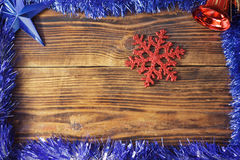 Large snowflakes on a wooden background Stock Image