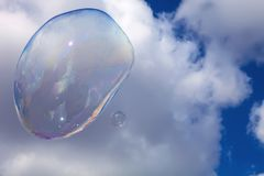 Large soap bubble before the clouds in the sky Royalty Free Stock Photos