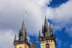 Large soap bubbles beneath the Old Town Hall in Prague, Czech Republic Stock Photo