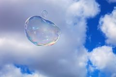 Large soap bubbles in the sky, the clouds Stock Photography
